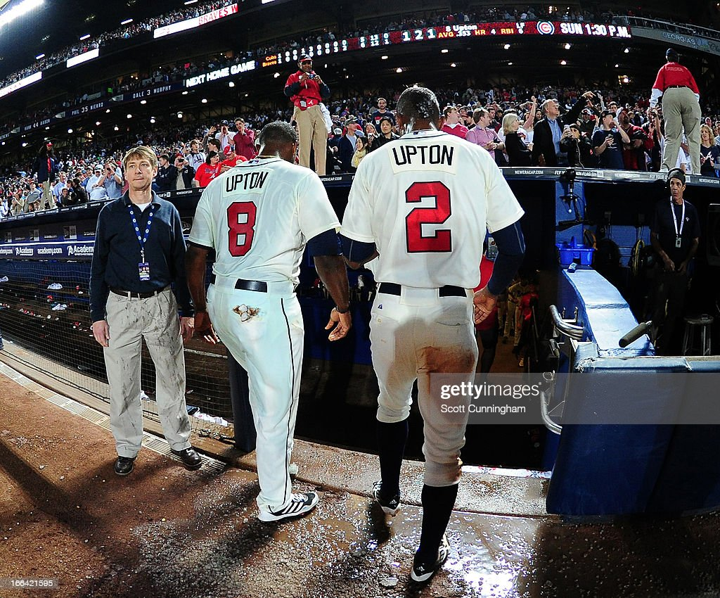 <a gi-track='captionPersonalityLinkClicked' href=/galleries/search?phrase=Justin+Upton&family=editorial&specificpeople=846265 ng-click='$event.stopPropagation()'>Justin Upton</a> #8 and his brother B. J. Upton #2 of the Atlanta Braves head off the field after the game against the Chicago Cubs at Turner Field on April 6, 2013 in Atlanta, Georgia.