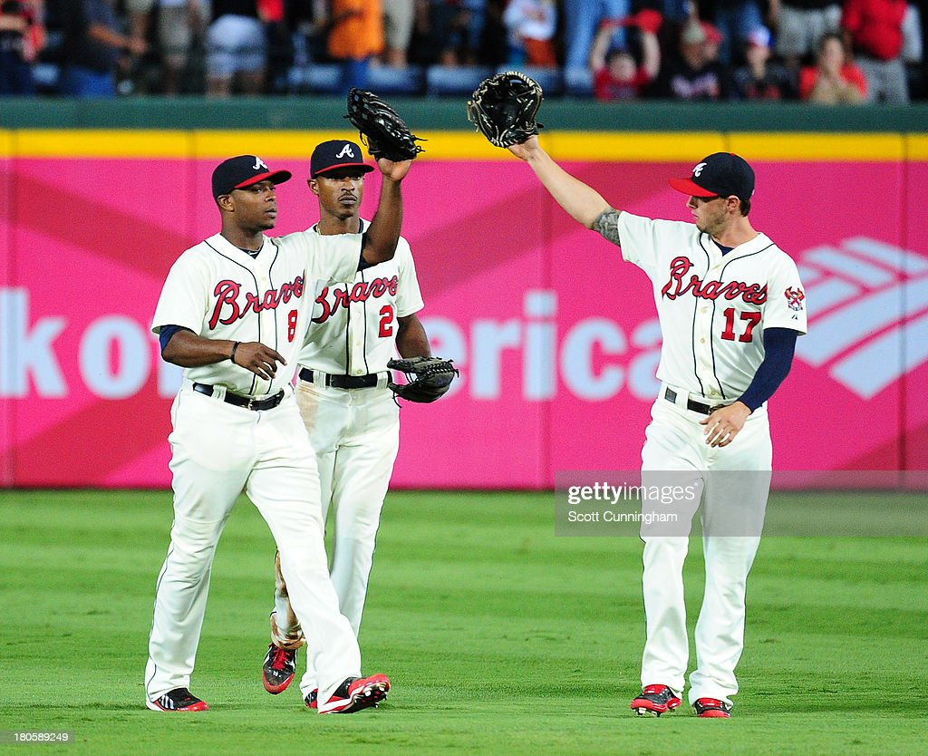 Justin Upton #8, B. J. Upton #2, and Jordan Schafer #17 of the Atlanta Braves celebrate after the game against the San Diego Padres at Turner Field on September 14, 2013 in Atlanta, Georgia.