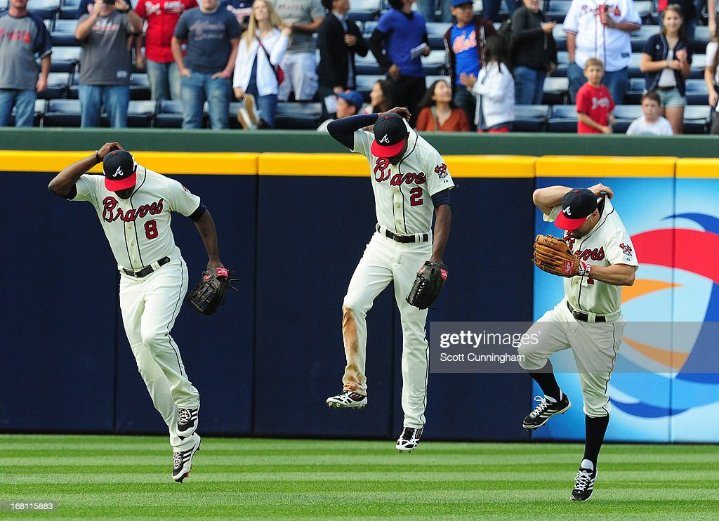 <a gi-track='captionPersonalityLinkClicked' href=/galleries/search?phrase=Justin+Upton&family=editorial&specificpeople=846265 ng-click='$event.stopPropagation()'>Justin Upton</a> #8, B. J. Upton #2, and <a gi-track='captionPersonalityLinkClicked' href=/galleries/search?phrase=Reed+Johnson&family=editorial&specificpeople=209105 ng-click='$event.stopPropagation()'>Reed Johnson</a> #7 (L-R) of the Atlanta Braves celebrate after the game against the New York Mets at Turner Field on May 5, 2013 in Atlanta, Georgia.