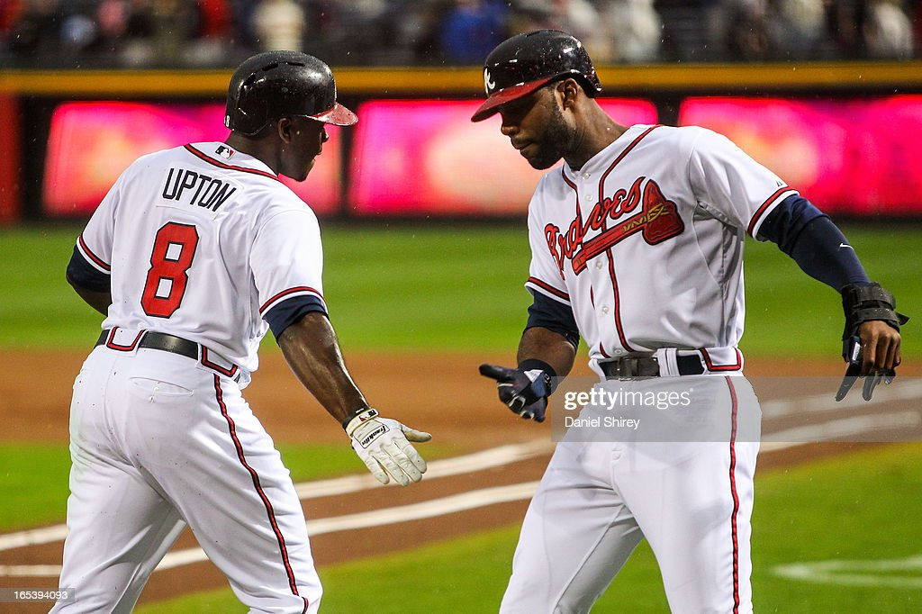 <a gi-track='captionPersonalityLinkClicked' href=/galleries/search?phrase=Justin+Upton&family=editorial&specificpeople=846265 ng-click='$event.stopPropagation()'>Justin Upton</a> #8 celebrates a two-run home run with <a gi-track='captionPersonalityLinkClicked' href=/galleries/search?phrase=Jason+Heyward&family=editorial&specificpeople=5043351 ng-click='$event.stopPropagation()'>Jason Heyward</a> #22 of the Atlanta Braves in the first inning of the game against the Philadelphia Phillies at Turner Field on April 3, 2013 in Atlanta, Georgia.