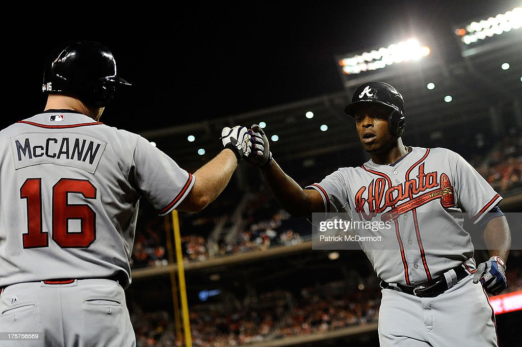<a gi-track='captionPersonalityLinkClicked' href=/galleries/search?phrase=Justin+Upton&family=editorial&specificpeople=846265 ng-click='$event.stopPropagation()'>Justin Upton</a> #8 celebrates with <a gi-track='captionPersonalityLinkClicked' href=/galleries/search?phrase=Brian+McCann+-+Baseball+Player&family=editorial&specificpeople=593065 ng-click='$event.stopPropagation()'>Brian McCann</a> #16 of the Atlanta Braves after hitting a solo home run in the seventh inning during a game against the Washington Nationals at Nationals Park on August 7, 2013 in Washington, DC.