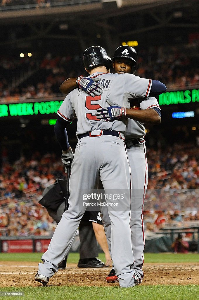 <a gi-track='captionPersonalityLinkClicked' href=/galleries/search?phrase=Justin+Upton&family=editorial&specificpeople=846265 ng-click='$event.stopPropagation()'>Justin Upton</a> #8 celebrates with <a gi-track='captionPersonalityLinkClicked' href=/galleries/search?phrase=Freddie+Freeman&family=editorial&specificpeople=5743987 ng-click='$event.stopPropagation()'>Freddie Freeman</a> #5 of the Atlanta Braves after hitting a solo home run in the seventh inning during a game against the Washington Nationals at Nationals Park on August 7, 2013 in Washington, DC.
