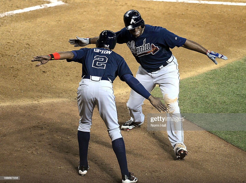 <a gi-track='captionPersonalityLinkClicked' href=/galleries/search?phrase=Justin+Upton&family=editorial&specificpeople=846265 ng-click='$event.stopPropagation()'>Justin Upton</a> #8 celebrates with his brother BJ Upton #2 of the Atlanta Braves after hitting a home run against the Arizona Diamondbacks at Chase Field on May 13, 2013 in Phoenix, Arizona.