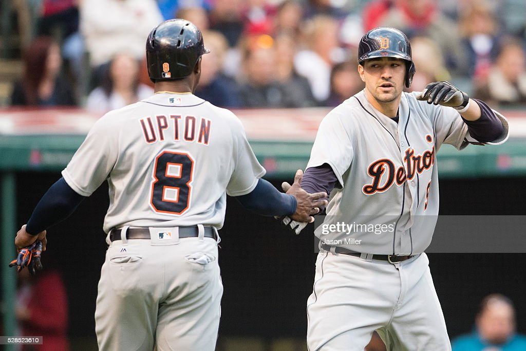 <a gi-track='captionPersonalityLinkClicked' href=/galleries/search?phrase=Justin+Upton&family=editorial&specificpeople=846265 ng-click='$event.stopPropagation()'>Justin Upton</a> #8 celebrates with <a gi-track='captionPersonalityLinkClicked' href=/galleries/search?phrase=Nick+Castellanos&family=editorial&specificpeople=6129175 ng-click='$event.stopPropagation()'>Nick Castellanos</a> #9 of the Detroit Tigers after both scored on a three run home run by Castellanos during the fourth inning against the Cleveland Indians at Progressive Field on May 5, 2016 in Cleveland, Ohio.
