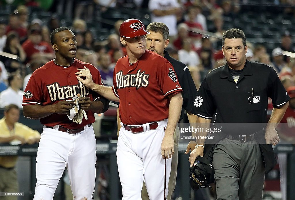 Justin Upton of the Arizona Diamondbacks argues with players after being hit by a pitch from the Washington Nationals during the sixth inning of the...