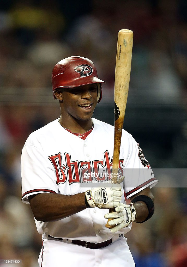 Justin Upton #10 of the Arizona Diamondbacks at bat against the Colorado Rockies during the MLB game at Chase Field on October 2, 2012 in Phoenix, Arizona.