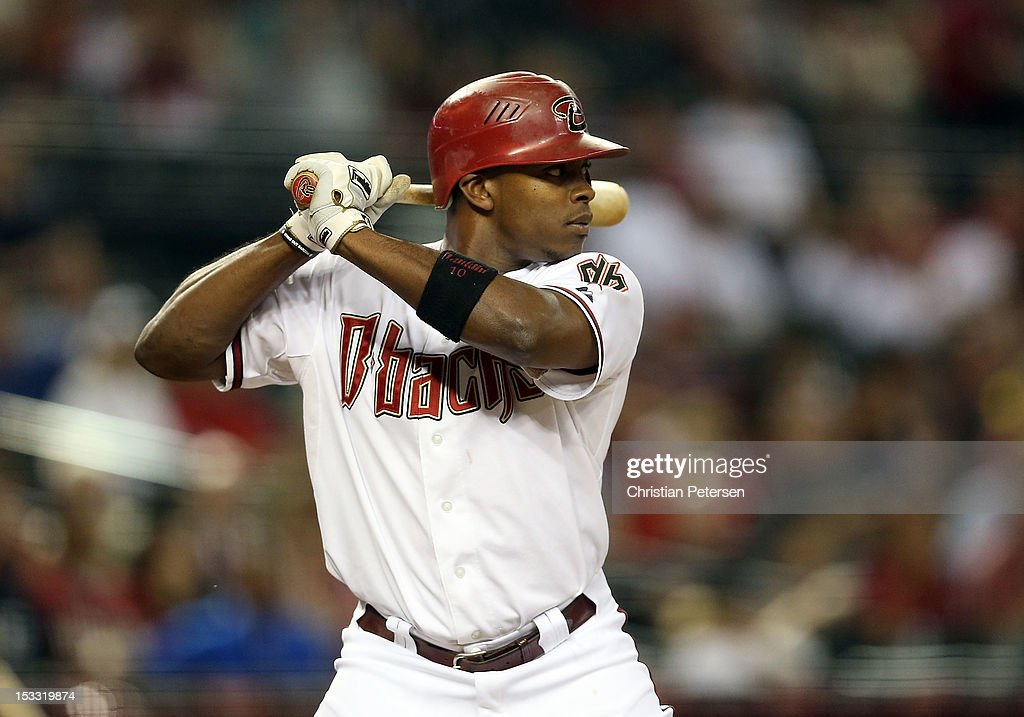 Justin Upton #10 of the Arizona Diamondbacks bats against the Colorado Rockies during the MLB game at Chase Field on October 2, 2012 in Phoenix, Arizona. The Diamondbacks defeated the Rockies 5-3.