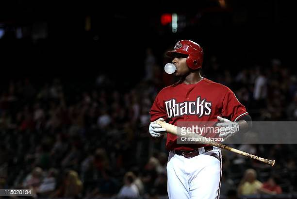 Justin Upton of the Arizona Diamondbacks blows a bubble as he bats against the Florida Marlins during the Major League Baseball game at Chase Field...