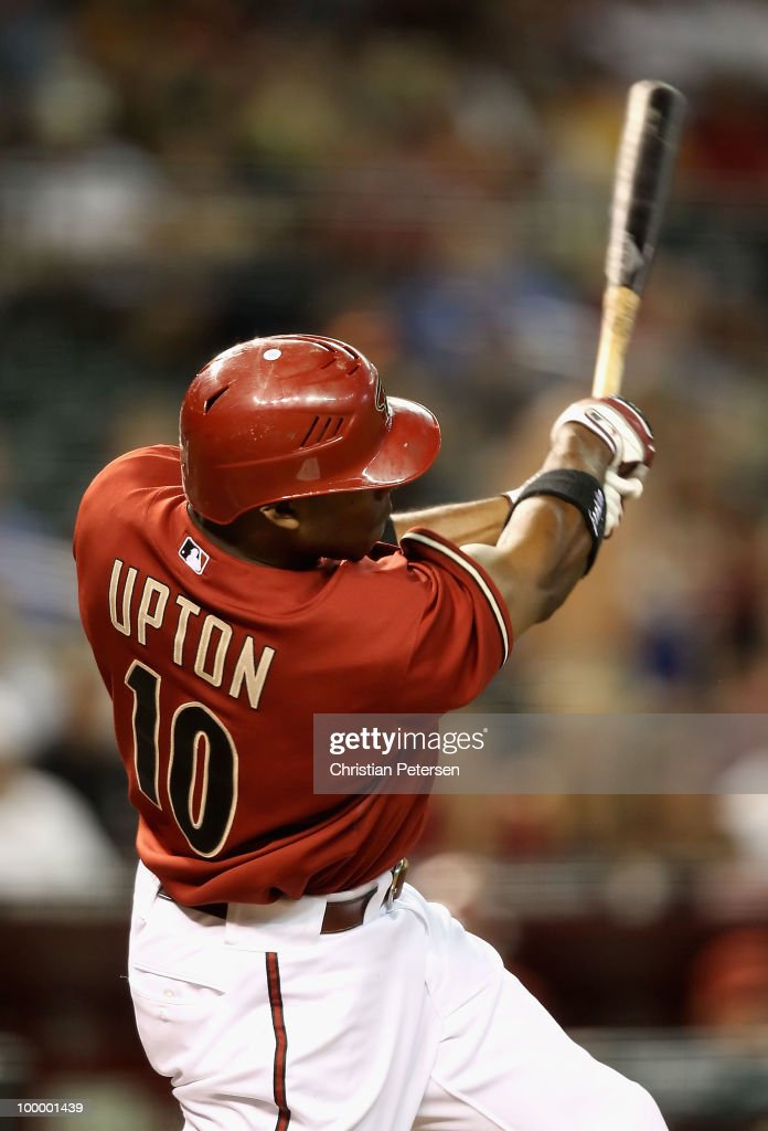 Justin Upton #10 of the Arizona Diamondbacks hits a solo home run against the San Francisco Giants during the fourth inning of the Major League Baseball game at Chase Field on May 19, 2010 in Phoenix, Arizona.