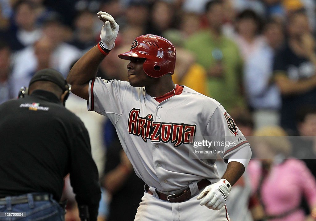 Justin Upton #10 of the Arizona Diamondbacks reacts after he hits a solo home run in the third inning off pitcher Yovani Gallardo #49 of the Milwaukee Brewers in Game Five of the National League Division Series at Miller Park on October 7, 2011 in Milwaukee, Wisconsin.