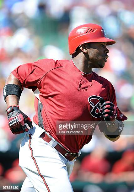 Justin Upton of the Arizona Diamondbacks runs to first base during a Spring Training game against the Los Angeles Angels of Anaheim on March 17 2010...