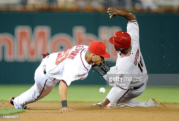 Justin Upton of the Arizona Diamondbacks steals second base in the sixth inning ahead of the throw to Ian Desmond of the Washington Nationals at...