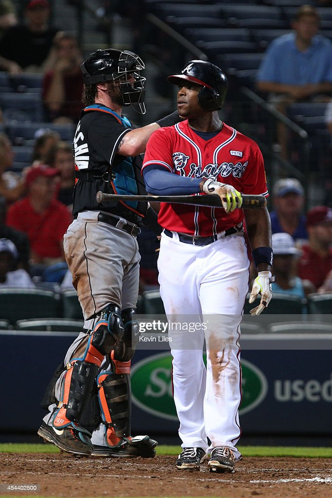 <a gi-track='captionPersonalityLinkClicked' href=/galleries/search?phrase=Justin+Upton&family=editorial&specificpeople=846265 ng-click='$event.stopPropagation()'>Justin Upton</a> #8 of the Atlanta Braves argues a call with the home plate umpire after striking out against the Miami Marlins during the ninth inning at Turner Field on August 30, 2014 in Atlanta, Georgia.