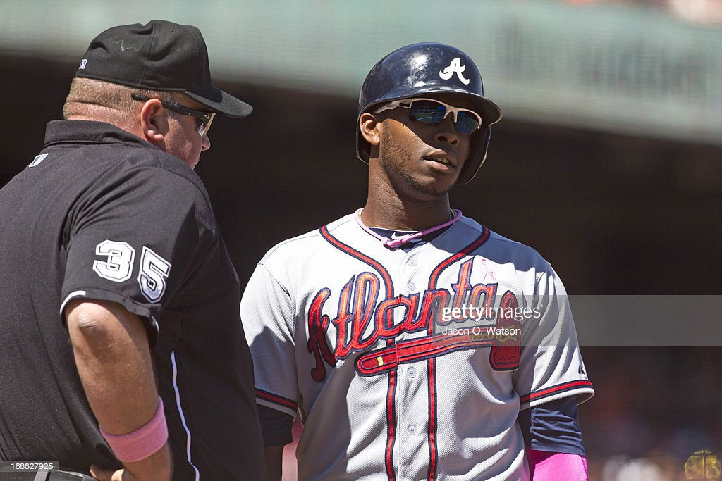 <a gi-track='captionPersonalityLinkClicked' href=/galleries/search?phrase=Justin+Upton&family=editorial&specificpeople=846265 ng-click='$event.stopPropagation()'>Justin Upton</a> #8 of the Atlanta Braves argues a called third strike with umpire <a gi-track='captionPersonalityLinkClicked' href=/galleries/search?phrase=Wally+Bell&family=editorial&specificpeople=228019 ng-click='$event.stopPropagation()'>Wally Bell</a> #35 during the sixth inning against the San Francisco Giants at AT&T Park on May 12, 2013 in San Francisco, California.