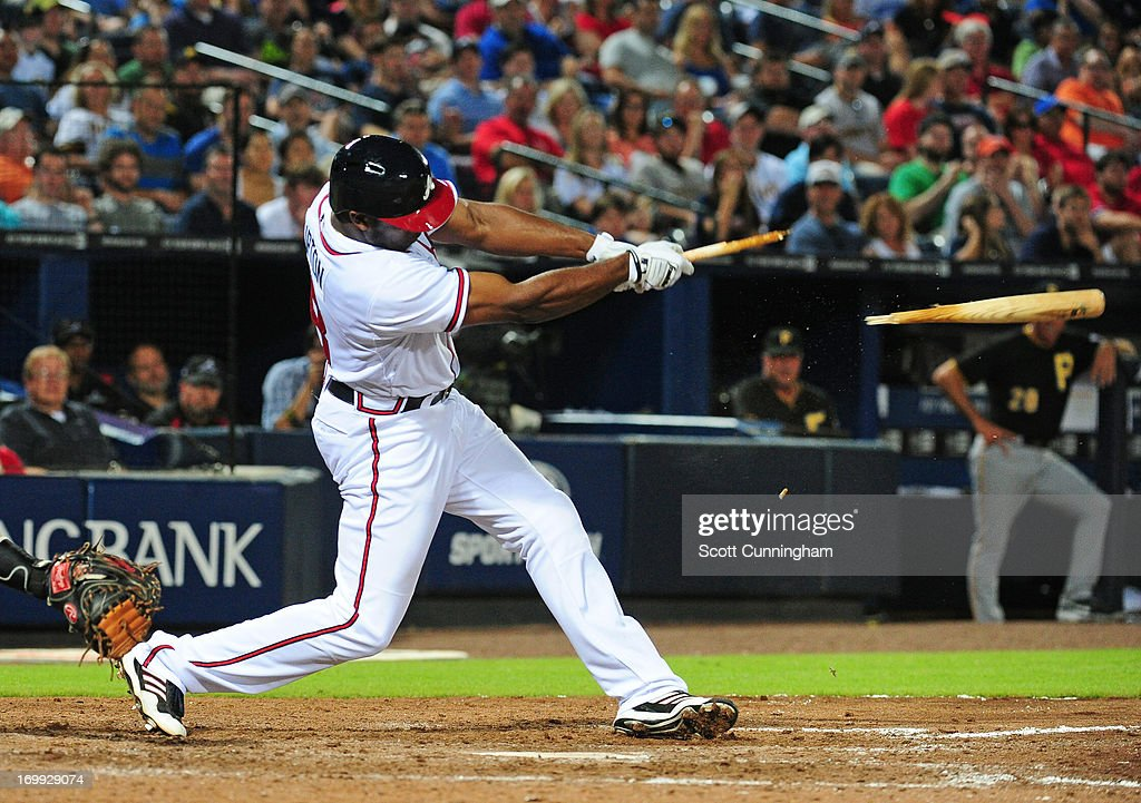 <a gi-track='captionPersonalityLinkClicked' href=/galleries/search?phrase=Justin+Upton&family=editorial&specificpeople=846265 ng-click='$event.stopPropagation()'>Justin Upton</a> #8 of the Atlanta Braves breaks his bat while hitting against the Pittsburgh Pirates at Turner Field on June 4, 2013 in Atlanta, Georgia.
