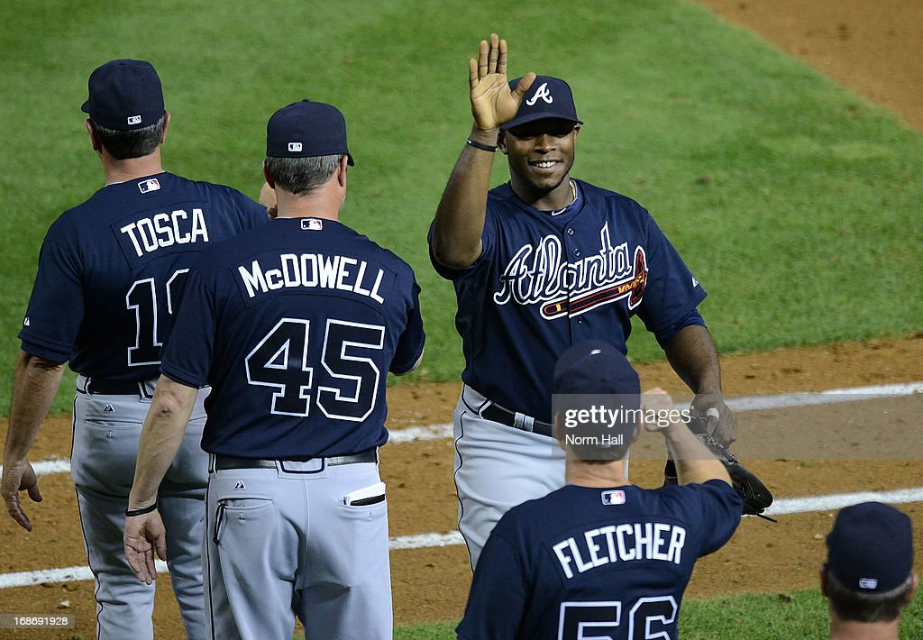 <a gi-track='captionPersonalityLinkClicked' href=/galleries/search?phrase=Justin+Upton&family=editorial&specificpeople=846265 ng-click='$event.stopPropagation()'>Justin Upton</a> #8 of the Atlanta Braves celebrates a 10-1 win against the Arizona Diamondbacks at Chase Field on May 13, 2013 in Phoenix, Arizona.