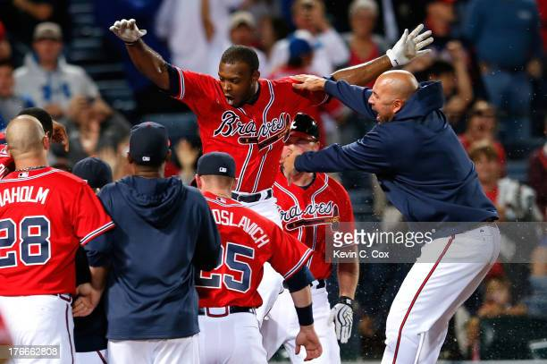Justin Upton of the Atlanta Braves celebrates after hitting a solo walkoff homer in the 10th inning against the Washington Nationals at Turner Field...