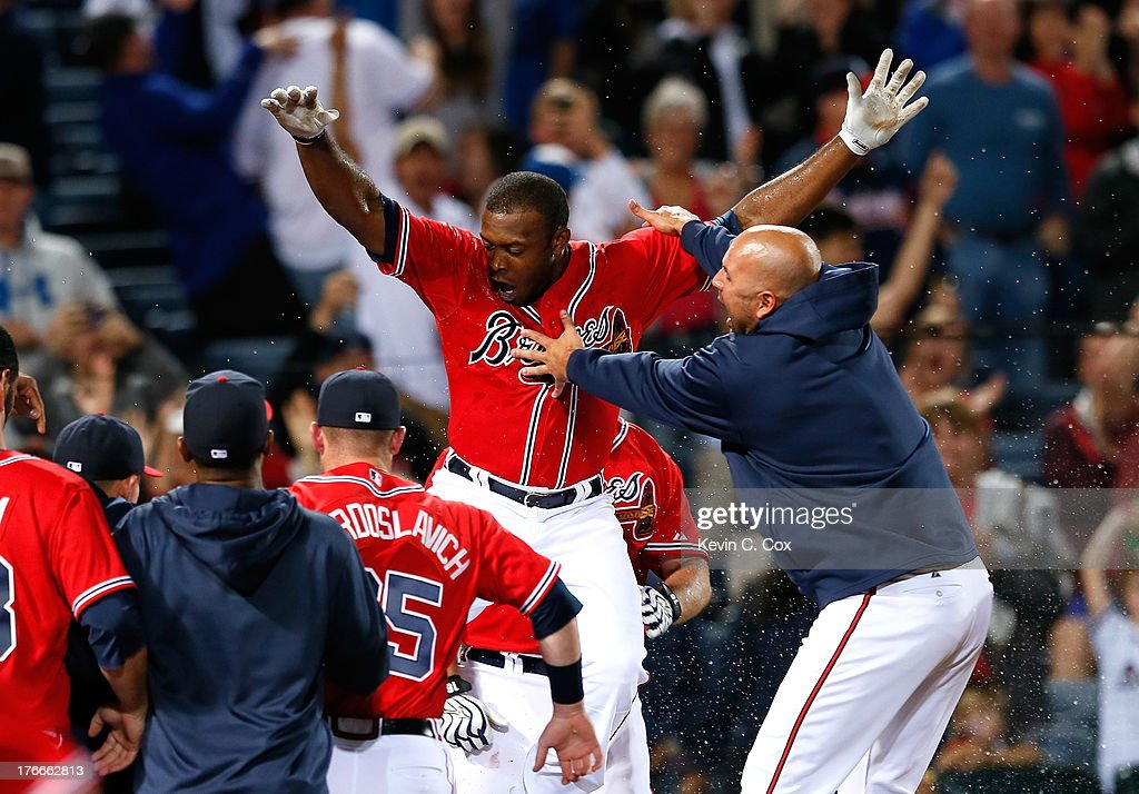 <a gi-track='captionPersonalityLinkClicked' href=/galleries/search?phrase=Justin+Upton&family=editorial&specificpeople=846265 ng-click='$event.stopPropagation()'>Justin Upton</a> #8 of the Atlanta Braves celebrates after hitting a solo walk-off homer in the 10th inning against the Washington Nationals at Turner Field on August 16, 2013 in Atlanta, Georgia.