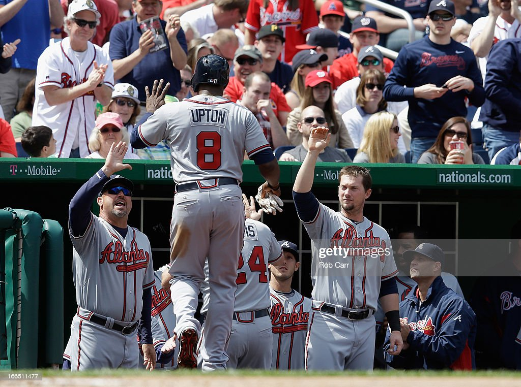 <a gi-track='captionPersonalityLinkClicked' href=/galleries/search?phrase=Justin+Upton&family=editorial&specificpeople=846265 ng-click='$event.stopPropagation()'>Justin Upton</a> #8 of the Atlanta Braves celebrates after scoring a run in the third inning against the Atlanta Braves at Nationals Park on April 13, 2013 in Washington, DC.