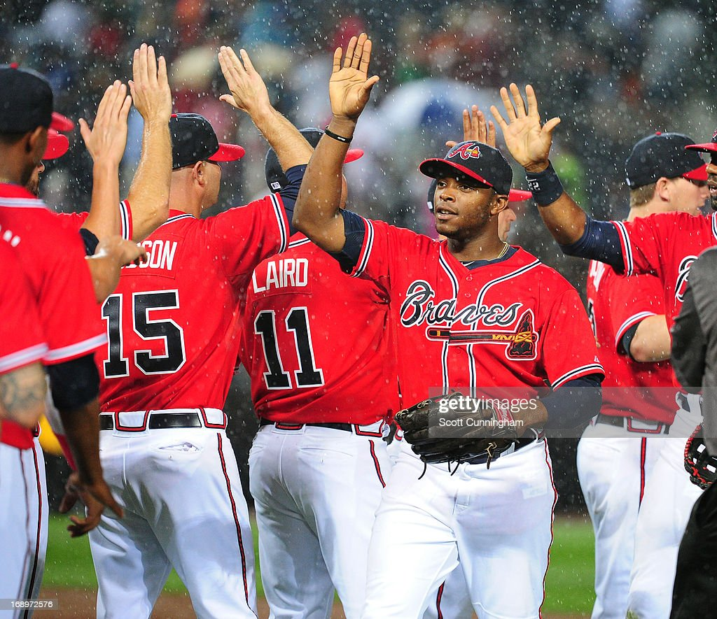 <a gi-track='captionPersonalityLinkClicked' href=/galleries/search?phrase=Justin+Upton&family=editorial&specificpeople=846265 ng-click='$event.stopPropagation()'>Justin Upton</a> #8 of the Atlanta Braves celebrates with teammates after the game against the Los Angeles Dodgers at Turner Field on May 17, 2013 in Atlanta, Georgia.