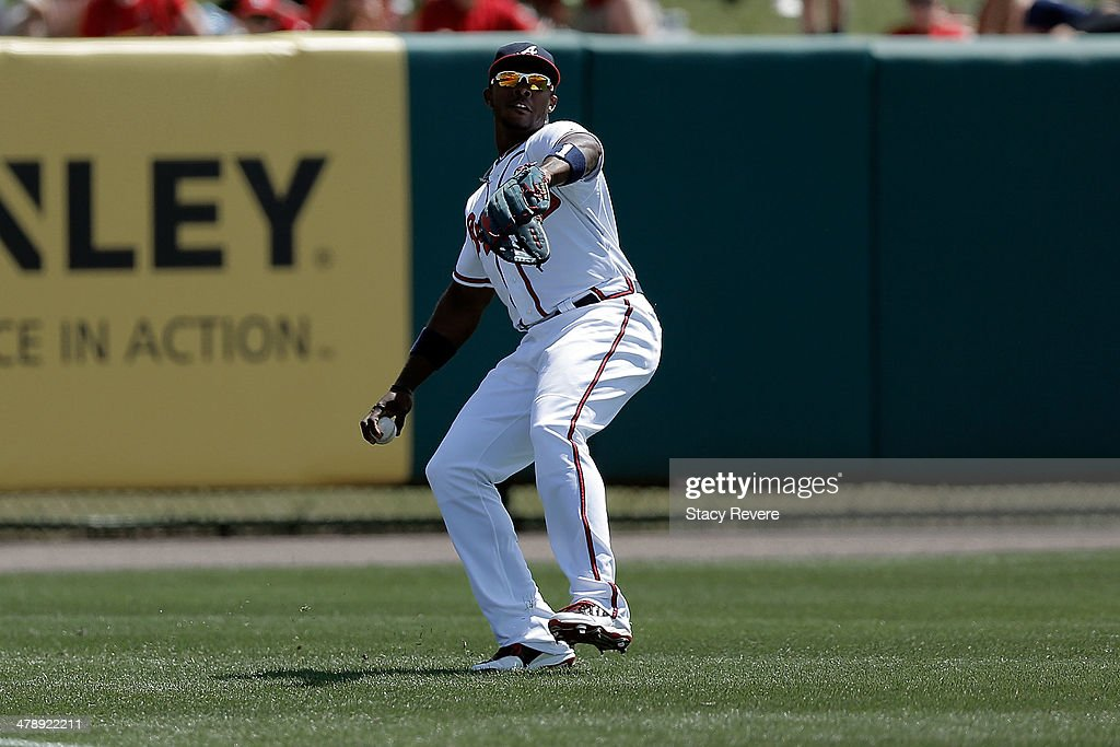 <a gi-track='captionPersonalityLinkClicked' href=/galleries/search?phrase=Justin+Upton&family=editorial&specificpeople=846265 ng-click='$event.stopPropagation()'>Justin Upton</a> #8 of the Atlanta Braves fields a ball in the second inning of a game against the St. Louis Cardinals at Champion Stadium on March 15, 2014 in Lake Buena Vista, Florida. St. Louis won the game 6-2.