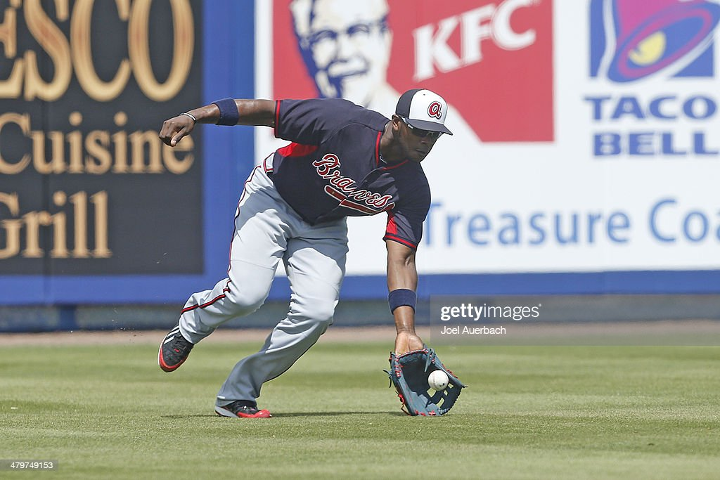 <a gi-track='captionPersonalityLinkClicked' href=/galleries/search?phrase=Justin+Upton&family=editorial&specificpeople=846265 ng-click='$event.stopPropagation()'>Justin Upton</a> #8 of the Atlanta Braves fields the ball hit by Ruben Tejada #11 of the New York Mets during a spring training game at Tradition Field on March 20, 2014 in Port St. Lucie, Florida.