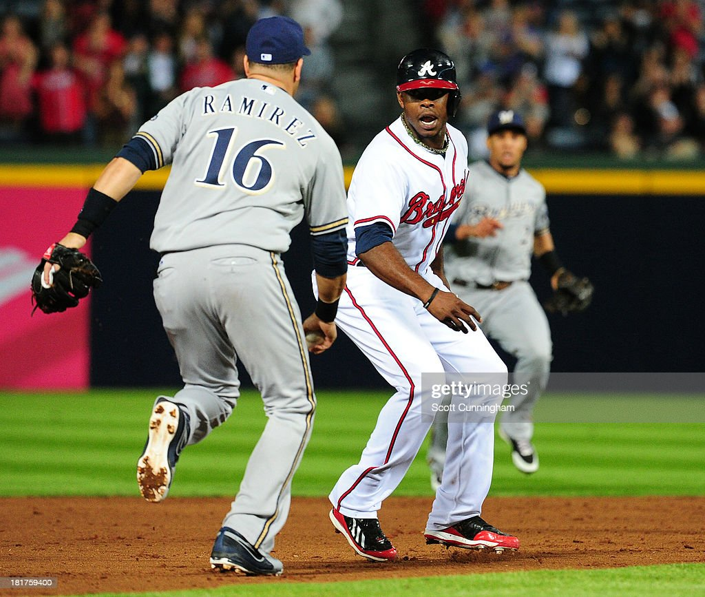 <a gi-track='captionPersonalityLinkClicked' href=/galleries/search?phrase=Justin+Upton&family=editorial&specificpeople=846265 ng-click='$event.stopPropagation()'>Justin Upton</a> #8 of the Atlanta Braves gets caught in a rundown against <a gi-track='captionPersonalityLinkClicked' href=/galleries/search?phrase=Aramis+Ramirez&family=editorial&specificpeople=239509 ng-click='$event.stopPropagation()'>Aramis Ramirez</a> #16 of the Milwaukee Brewers at Turner Field on September 24, 2013 in Atlanta, Georgia.