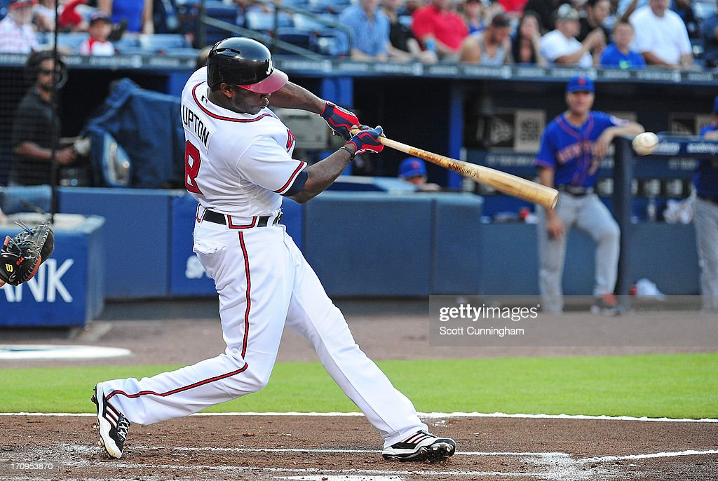 <a gi-track='captionPersonalityLinkClicked' href=/galleries/search?phrase=Justin+Upton&family=editorial&specificpeople=846265 ng-click='$event.stopPropagation()'>Justin Upton</a> #8 of the Atlanta Braves hits a first inning run scoring single against the New York Mets at Turner Field on June 20, 2013 in Atlanta, Georgia.