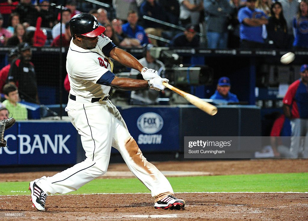 <a gi-track='captionPersonalityLinkClicked' href=/galleries/search?phrase=Justin+Upton&family=editorial&specificpeople=846265 ng-click='$event.stopPropagation()'>Justin Upton</a> #8 of the Atlanta Braves hits a ninth inning with a game-winning home run against the Chicago Cubs at Turner Field on April 6, 2013 in Atlanta, Georgia.