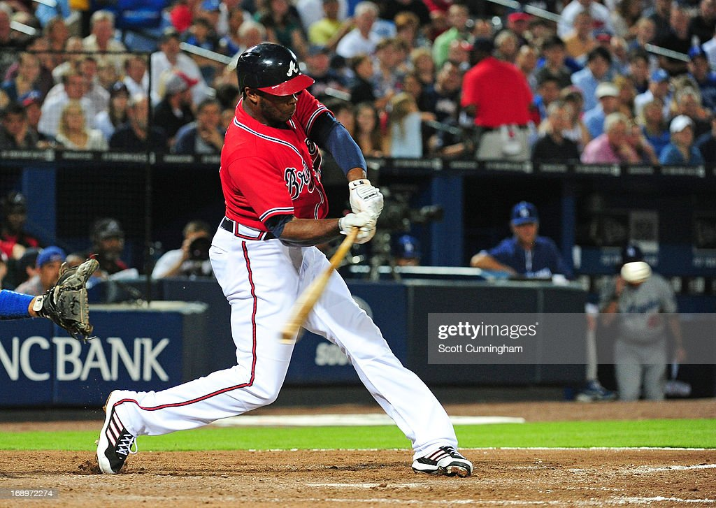 <a gi-track='captionPersonalityLinkClicked' href=/galleries/search?phrase=Justin+Upton&family=editorial&specificpeople=846265 ng-click='$event.stopPropagation()'>Justin Upton</a> #8 of the Atlanta Braves hits a sixth-inning grand slam against the Los Angeles Dodgers at Turner Field on May 17, 2013 in Atlanta, Georgia.