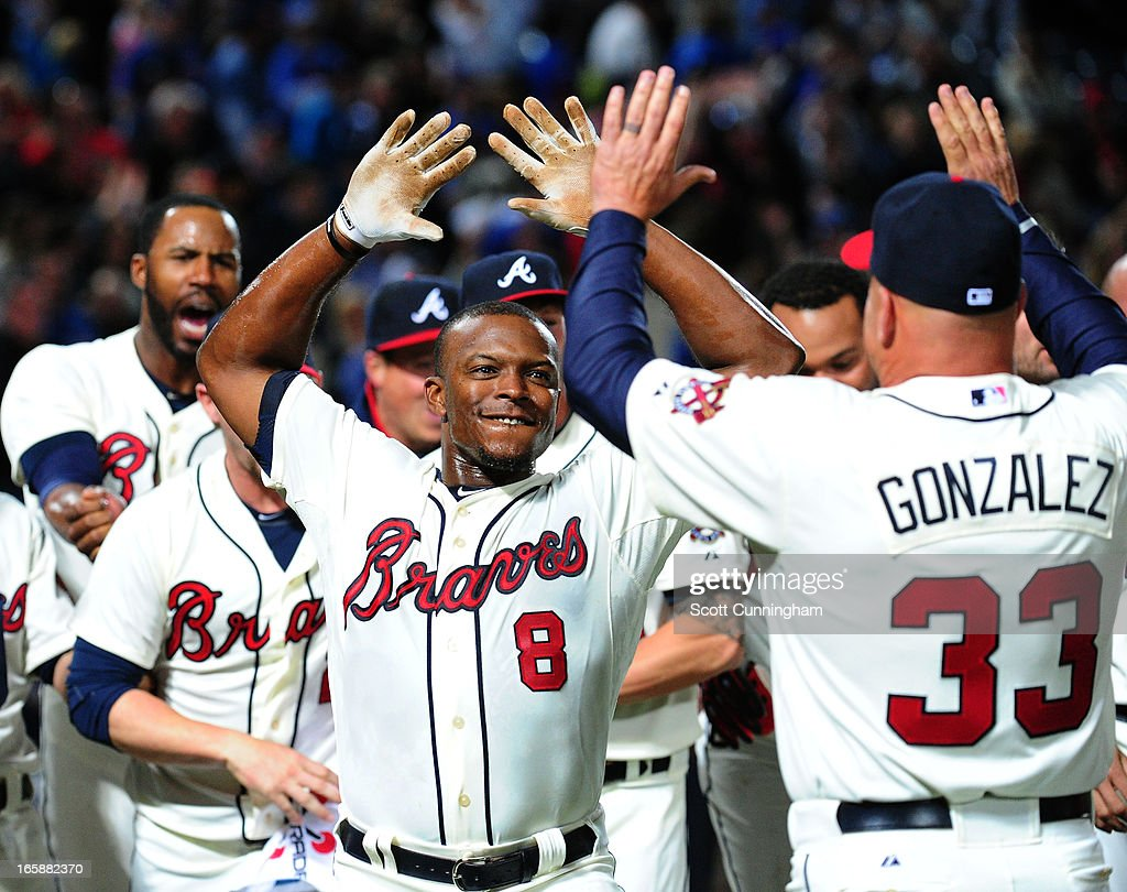 <a gi-track='captionPersonalityLinkClicked' href=/galleries/search?phrase=Justin+Upton&family=editorial&specificpeople=846265 ng-click='$event.stopPropagation()'>Justin Upton</a> #8 of the Atlanta Braves is congratulated by Manager <a gi-track='captionPersonalityLinkClicked' href=/galleries/search?phrase=Fredi+Gonzalez&family=editorial&specificpeople=686896 ng-click='$event.stopPropagation()'>Fredi Gonzalez</a> #33 after his ninth inning game-winning home run against the Chicago Cubs at Turner Field on April 6, 2013 in Atlanta, Georgia.