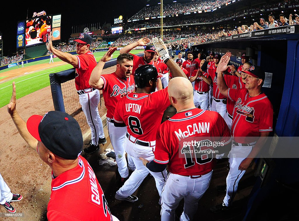 <a gi-track='captionPersonalityLinkClicked' href=/galleries/search?phrase=Justin+Upton&family=editorial&specificpeople=846265 ng-click='$event.stopPropagation()'>Justin Upton</a> #8 of the Atlanta Braves is congratulated by teammates after hitting a sixth-inning grand slam against the Los Angeles Dodgers at Turner Field on May 17, 2013 in Atlanta, Georgia.