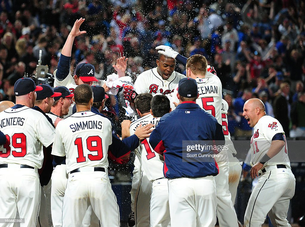 <a gi-track='captionPersonalityLinkClicked' href=/galleries/search?phrase=Justin+Upton&family=editorial&specificpeople=846265 ng-click='$event.stopPropagation()'>Justin Upton</a> #8 of the Atlanta Braves is congratulated by teammates after his ninth inning game-winning home run against the Chicago Cubs at Turner Field on April 6, 2013 in Atlanta, Georgia.