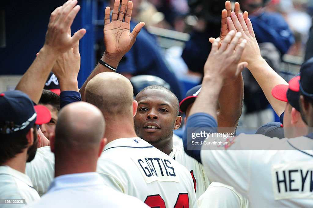 <a gi-track='captionPersonalityLinkClicked' href=/galleries/search?phrase=Justin+Upton&family=editorial&specificpeople=846265 ng-click='$event.stopPropagation()'>Justin Upton</a> #8 of the Atlanta Braves is congratulated by teammates after scoring against the New York Mets at Turner Field on May 5, 2013 in Atlanta, Georgia.