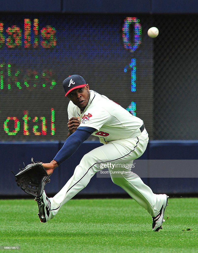 <a gi-track='captionPersonalityLinkClicked' href=/galleries/search?phrase=Justin+Upton&family=editorial&specificpeople=846265 ng-click='$event.stopPropagation()'>Justin Upton</a> #8 of the Atlanta Braves is unable to make a running catch against the Los Angeles Dodgers at Turner Field on May 19, 2013 in Atlanta, Georgia.