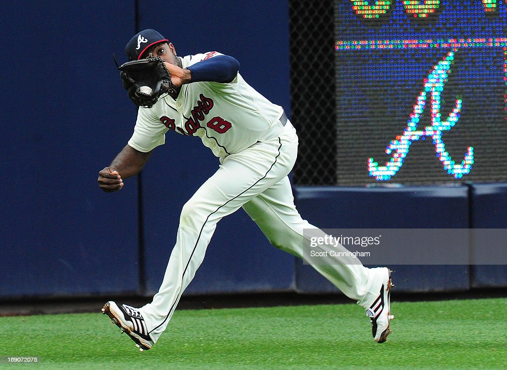 <a gi-track='captionPersonalityLinkClicked' href=/galleries/search?phrase=Justin+Upton&family=editorial&specificpeople=846265 ng-click='$event.stopPropagation()'>Justin Upton</a> #8 of the Atlanta Braves makes a running catch against the Los Angeles Dodgers at Turner Field on May 19, 2013 in Atlanta, Georgia.