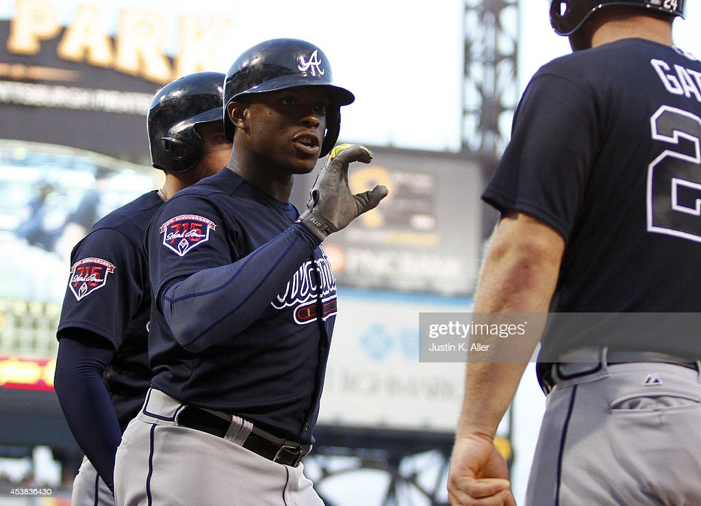 Justin Upton #8 of the Atlanta Braves reacts after hitting a three run home run in the fourth inning against the Pittsburgh Pirates during the game at PNC Park on August 19, 2014 in Pittsburgh, Pennsylvania.