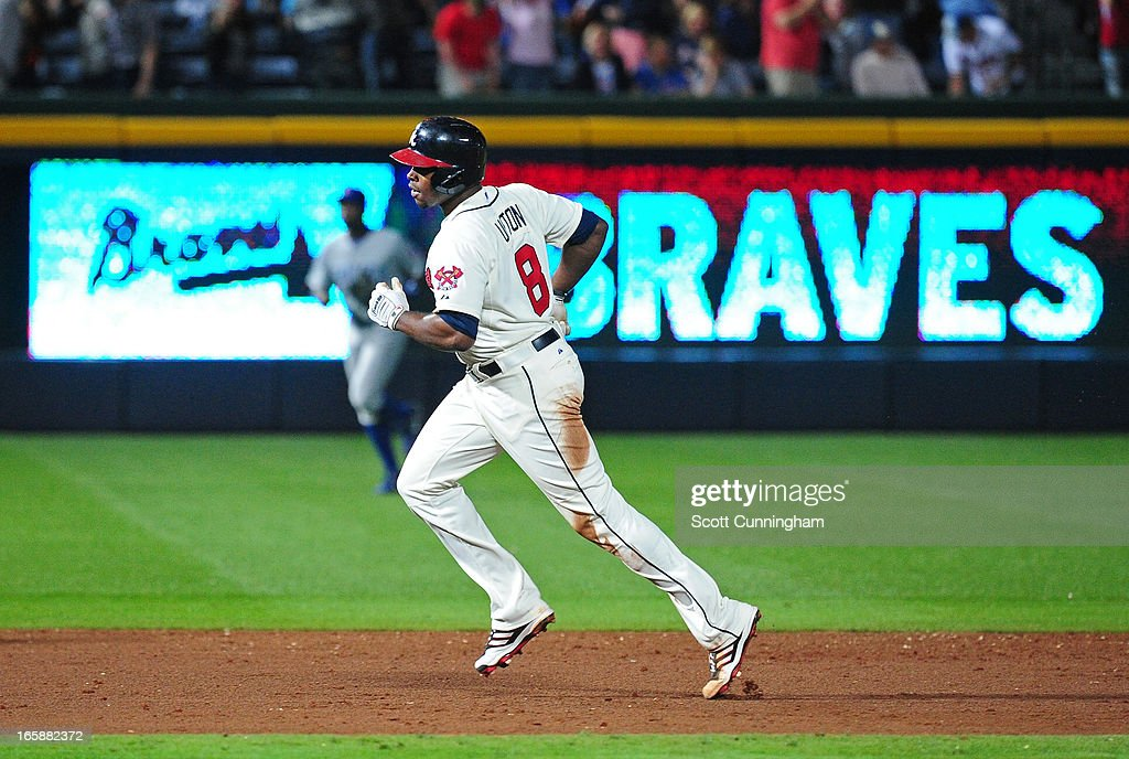 <a gi-track='captionPersonalityLinkClicked' href=/galleries/search?phrase=Justin+Upton&family=editorial&specificpeople=846265 ng-click='$event.stopPropagation()'>Justin Upton</a> #8 of the Atlanta Braves rounds the bases after his ninth inning game-winning home run against the Chicago Cubs at Turner Field on April 6, 2013 in Atlanta, Georgia.