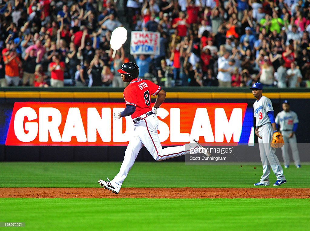 <a gi-track='captionPersonalityLinkClicked' href=/galleries/search?phrase=Justin+Upton&family=editorial&specificpeople=846265 ng-click='$event.stopPropagation()'>Justin Upton</a> #8 of the Atlanta Braves rounds the bases after hitting a sixth-inning grand slam against the Los Angeles Dodgers at Turner Field on May 17, 2013 in Atlanta, Georgia.