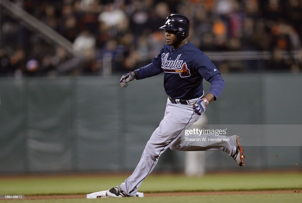 <a gi-track='captionPersonalityLinkClicked' href=/galleries/search?phrase=Justin+Upton&family=editorial&specificpeople=846265 ng-click='$event.stopPropagation()'>Justin Upton</a> #8 of the Atlanta Braves runs the bases, on his way to a triple against the San Francisco Giants in the fifth inning at AT&T Park on May 9, 2013 in San Francisco, California.