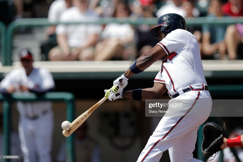 <a gi-track='captionPersonalityLinkClicked' href=/galleries/search?phrase=Justin+Upton&family=editorial&specificpeople=846265 ng-click='$event.stopPropagation()'>Justin Upton</a> #8 of the Atlanta Braves swings at a pitch in the first inning of a game against the St. Louis Cardinals at Champion Stadium on March 15, 2014 in Lake Buena Vista, Florida. St. Louis won the game 6-2.