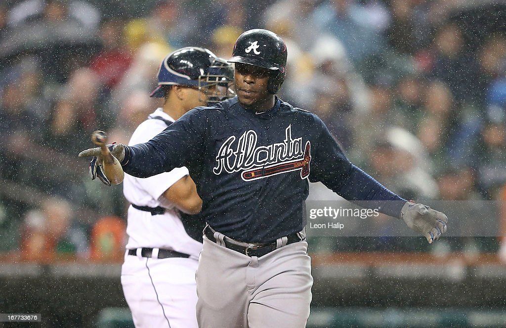 Justin Upton #8 of the Atlanta Braves throws the bat after getting hit by a pitch during the fourth inning of the game against the Detroit Tigers at Comerica Park on April 28, 2013 in Detroit, Michigan.
