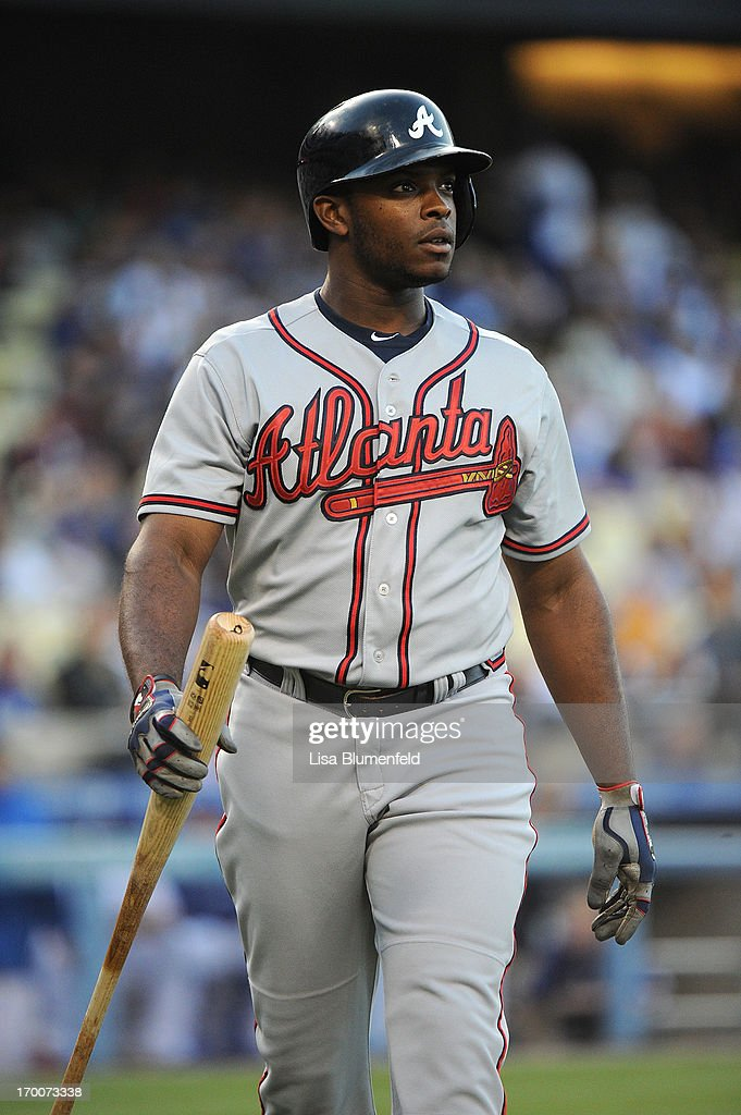 <a gi-track='captionPersonalityLinkClicked' href=/galleries/search?phrase=Justin+Upton&family=editorial&specificpeople=846265 ng-click='$event.stopPropagation()'>Justin Upton</a> #8 of the Atlanta Braves walks back to the dugout after striking out in the first inning against the Los Angeles Dodgers at Dodger Stadium on June 6, 2013 in Los Angeles, California.
