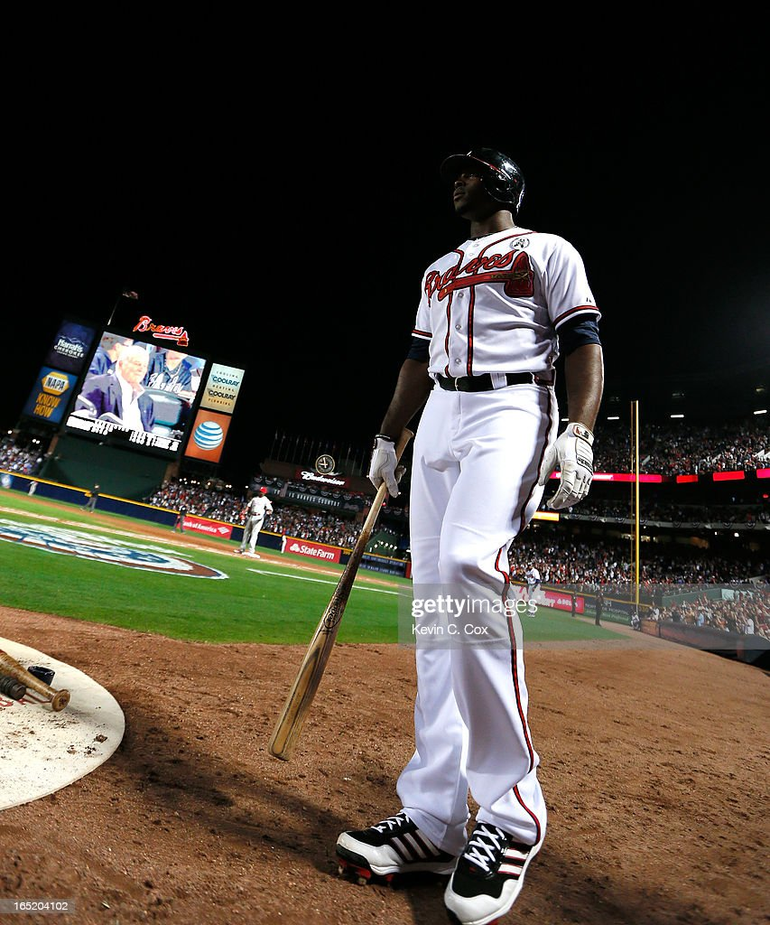 Justin Upton #8 of the Atlanta Braves walks into the batting box against the Philadelphia Phillies in the fifth inning during Opening Day at Turner Field on April 1, 2013 in Atlanta, Georgia.