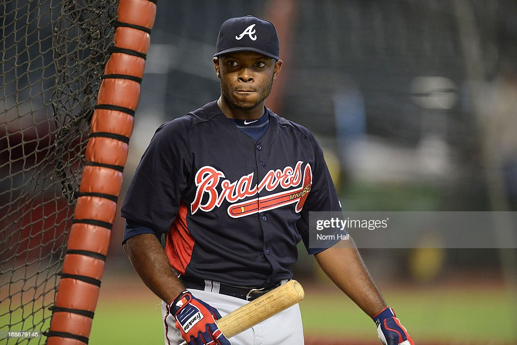 Justin Upton #8 of the Atlanta Braves warms up in the batting cage prior to a game against his former team the Arizona Diamondbacks at Chase Field on May 13, 2013 in Phoenix, Arizona.