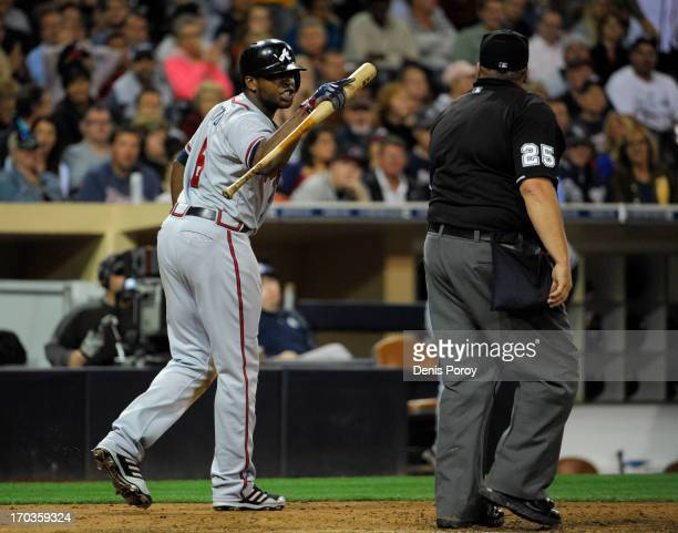 Justin Upton of the Atlanta Braves yells at home plate umpire Fieldin Culbreth after a called strike out during the eighth inning of a baseball game...