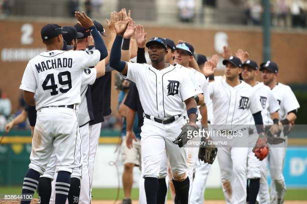 Justin Upton of the Detroit Tigers and Dixon Machado celebrate a 106 win over the New York Yankees at Comerica Park on August 24 2017 in Detroit...