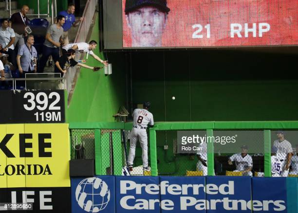 Justin Upton of the Detroit Tigers and the American League is unable to catch a solo home run ball hit by Yadier Molina of the St Louis Cardinals and...