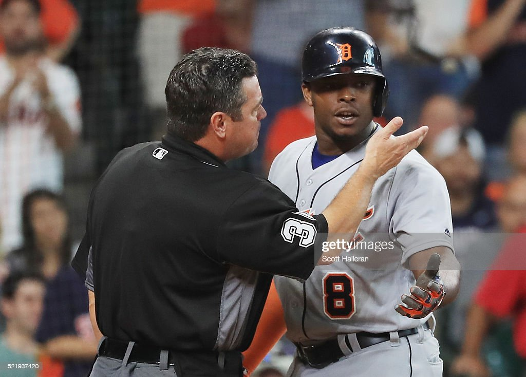 Justin Upton of the Detroit Tigers argues with umpire Rob Drake after being called out on strikes during the seventh inning of their game against the...