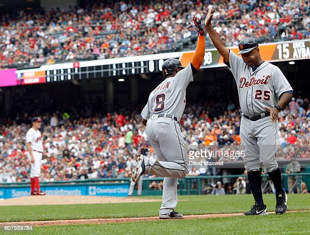 Justin Upton of the Detroit Tigers celebrates with Third Base Coach Dave Clark after hitting a two run home run against the Cleveland Indians in the...